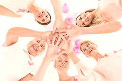 Struggle with cancer. Happy women in different age with power to struggle with breast cancer Stock Photo