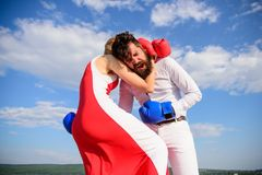Struggle for equality rights. Exact hit. Learn how to defend yourself. Man and woman boxing gloves fight blue sky. Struggle for equality rights. Exact hit. Learn stock photo