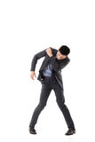 Struggle pose of Asian business man. Full length isolated Royalty Free Stock Photos