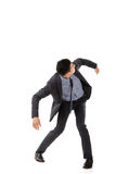 Struggle pose of Asian business man. Full length isolated Stock Image