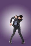 Struggle pose of Asian business man Stock Image