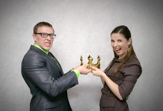 Struggle for power. First place struggle concept. Race for power. Two person pull golden crown at each other isolated on gray background stock image