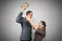 Struggle for power. Race for power. First place struggle concept. Man took and did not give the crown to another women isolated on gray background stock images