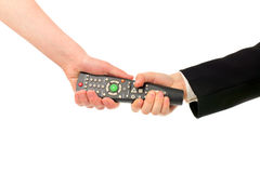 Struggle for remote control. Adult and boy hands struggle for remote control isolated royalty free stock image