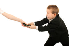 Struggle for remote control. Boy struggle for remote control isolated royalty free stock photos