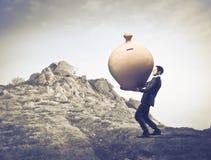 Struggle for savings Stock Photo