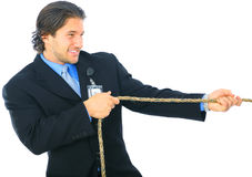 Struggle Young Man Pulling Rope Stock Photography