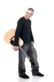 Struggling artist, singer. Handsome youngster, male teenager with guitar, sturdy troubled expression,  white background Royalty Free Stock Image