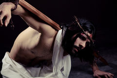 Struggling Jesus Christ for Easter. With the cross on his back Stock Images