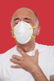 Struggling man wearing a mask Stock Photography