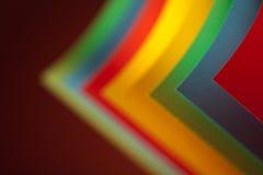 Struktur des farbigen Papiers des Auszuges auf rotem Hintergrund Lizenzfreies Stockbild