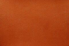 Strukturelle Oberfläche der roten Haut Stockfotografie