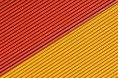 Strukturierte bunte gelbe und orange Wellpappe lizenzfreie stockfotos