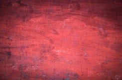 Strukturierte rote Wand des Dorfhauses Stockfotografie