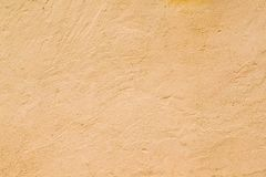 Strukturierte Wand der orange Farbe Stockbilder