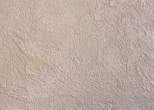 Strukturierter Hintergrund der beige rauen Wand Abstact-Stuck Beschaffenheit des Gipses auf der Wand Stockbild