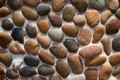 Strukturierter Hintergrund der Kieselmosaik-Wand Mit Ziegeln gedeckter Steindekorationsdesignhintergrund Lizenzfreie Stockfotos