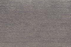 Strukturierter Hintergrund der polymerischen materiellen grauen braunen Farbe Lizenzfreies Stockbild
