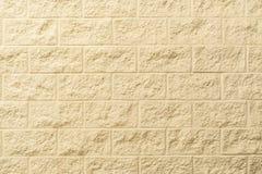 Strukturierter Hintergrund des Sahneziegelsteines Stockbilder