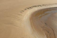 Strukturierter Hintergrund des Sandes Stockbilder