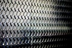 Strukturierter perforierter metallischer Hintergrund Stockfotos