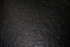 Strukturierter reiner dunkelgrauer Granit Stockfoto