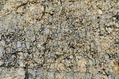 Strukturierter Steinhintergrund Schuttballast in der Wildform in der Felsenwand Lizenzfreie Stockbilder