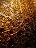 Strukturierter Stoff von den Mustern der Goldfarbe Lizenzfreie Stockfotografie