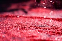 Strukturiertes abstraktes Hintergrund Funkeln-Rot Stockbild