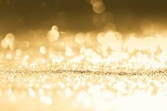 Strukturiertes abstraktes Hintergrund Funkelngold Stockfotos