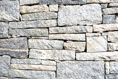 Strukturiertes geometrisches Muster einer Granitsteinwand Lizenzfreies Stockbild
