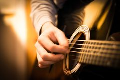 Strum of the Guitar royalty free stock photography