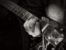 Strum the guitar. A musician is strumming his guitar stock images