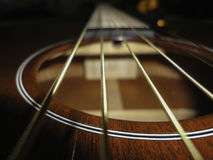 Strum Me. Down the line and into the sound hole where vibration escapes stock images