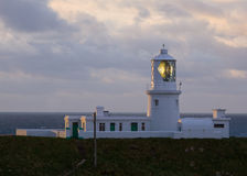 Strumble Head Lighthouse at dusk. Strumble Head lighthouse in operation at dusk, Pembrokeshire, Wales Stock Photography