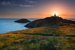 Strumble Head Lighthouse at sunset Royalty Free Stock Photo