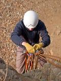 Strumentazione e scalatore di alpinismo Fotografie Stock