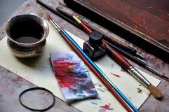 Strumenti del pittore sulle vie di Firenze Immagine Stock