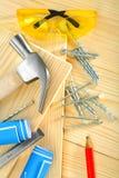 Strumenti di carpenteria su priorità bassa di legno Fotografia Stock Libera da Diritti