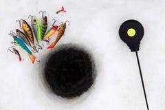Strumenti di pesca del ghiaccio fotografia stock libera da diritti
