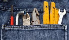 Strumenti e casella dei jeans Immagine Stock Libera da Diritti