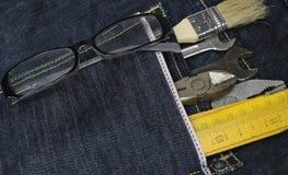 Strumenti e casella dei jeans Immagini Stock
