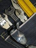Strumenti e casella dei jeans Fotografia Stock
