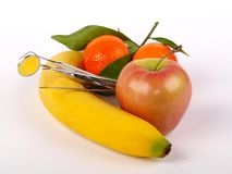 Strumenti e frutta del dentista Immagine Stock