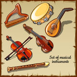 Strumenti musicali del vento e della corda, sei icone Fotografie Stock
