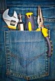 Strumenti su una casella di pantaloni Fotografia Stock Libera da Diritti