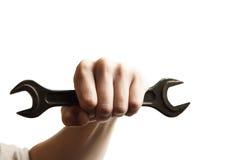 Strumento della chiave della tenuta della mano a disposizione Fotografie Stock