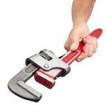 Strumento della chiave di tubo della holding della mano Fotografia Stock