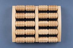 Strumento di legno di massaggio del rullo per i piedi Fotografia Stock