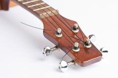 Strumento di musica delle ukulele sui precedenti bianchi Fotografie Stock
